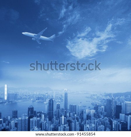 hongkong's skyscrapers and airplanes on sky