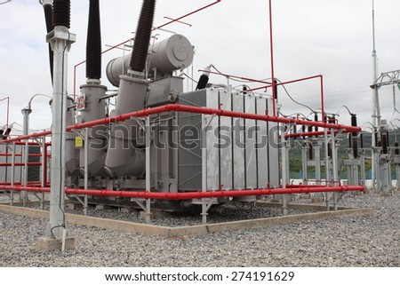 HONGSA - LAO PDR - JULY 23 : Outdoor extra high voltage power switchgear equipment infront of coal fire power plant under-construction on July 23, 2014 in Hongsa District, Lao PDR.