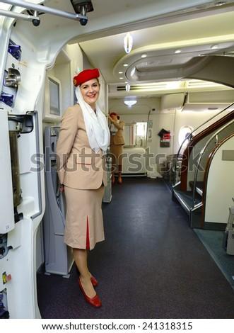 HONK KONG- OCT 17: Emirates crew member meet passengers in Airbus A380 on October 17, 2014 in Hong Kong, China. Emirates handles major part of passenger traffic and aircraft movements at the airport. - stock photo