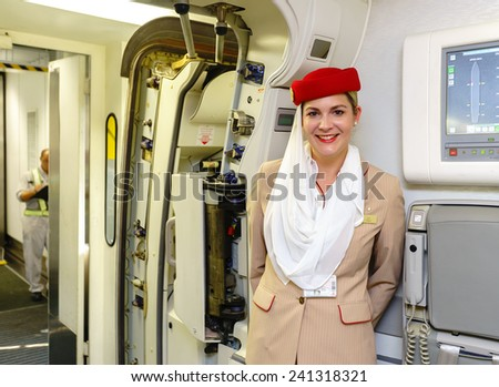 HONK KONG- OCT 17: Emirates crew member meet passengers in Airbus A380 on October 17, 2014 in Hong Kong, China. Emirates handles major part of passenger traffic and aircraft movements at the airport.