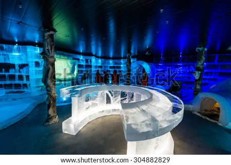 HONNINGSVAG, NORWAY - JULY 01, 2014: The Artico Ice Bar is one of the most important places to visit in Honningsvag, on Mageroya Island in Nordkapp, Norway - stock photo