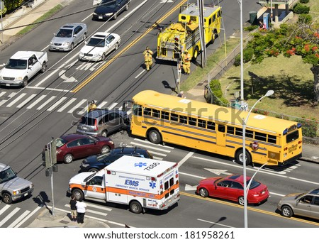 HONOLULU - APRIL 12, 2012: Firefighters and medical response units arrive at the scene of an accident in Honolulu, Hawaii.   - stock photo