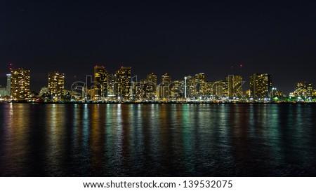 Honolulu cityscape with Waikiki yacht club and seafront at sunset - stock photo