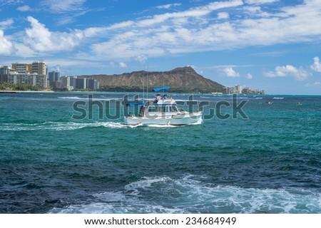 Honolulu, Dec. 1:  Pleasure boat leaving the Ala Wai Small Boat Harbor in good weather.  Honolulu, Hawaii, USA.  Dec. 1, 2014 - stock photo
