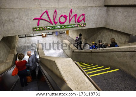 HONOLULU - DECEMBER 27, 2013: A sign welcomes people to Honolulu International Airport on December 27, 2013.   Honolulu is one of the busiest airports in the US, with 21 million passengers a year. - stock photo
