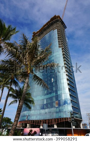 HONOLULU - FEBRUARY 21: Luxury Condo Building Waiea, pinnacle of high-end living on Ala Moana Boulevard, 36-floor tower under construction in Ward Village Honolulu, Hawaii February 21, 2016. - stock photo