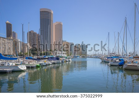Honolulu, Hawaii, USA, Feb. 10, 2016:  Morning view of the Ala Wai Harbor with Waikiki hotels in the background.