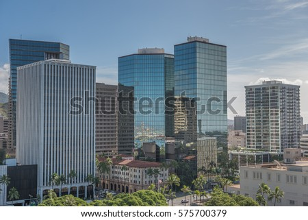 Honolulu, Hawaii, USA, Feb. 9, 2017:  Morning view of the Honolulu Financial District  with a tropical blue sky above.