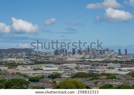 Honolulu, Hawaii, USA, July 22, 2015:  Afternoon view of Punchbowl Crater which is protected from development while Diamond Head is disappearing in the current Honolulu construction boom.