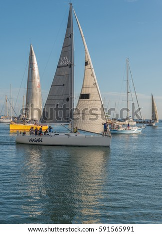 Honolulu, Hawaii, USA, Mar. 2, 2017:  Sailboats maneuvering in the Ala Moana Channel as they prepare to sail to Waikiki on a warm Spring afternoon.