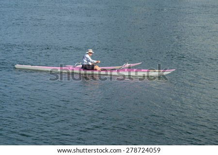Honolulu, Hawaii, USA, May 17, 2015: Active Senior citizens in Honolulu, Hawaii, are training for the upcoming State Outrigger Canoe Competition. Honolulu is a world-class destination for water sports - stock photo