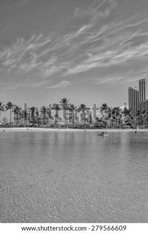 Honolulu, Hawaii, USA, May 20, 2015:  Honolulu Lagoon is a center for water sports and sun bathing for residents and tourists.  Honolulu is famous for water sports and recreation. - stock photo