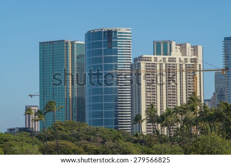 Honolulu, Hawaii, USA, May 20, 2015:  Morning view of the new Honolulu skyline with more cranes in place to build more high rise condominiums for the increased  housing demand in Honolulu. - stock photo