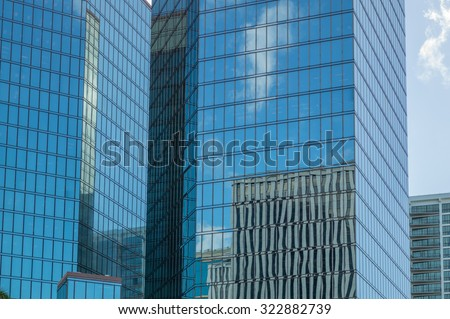 Honolulu, Hawaii, USA, Oct. 1, 2015:  Bishop Street skyscrapers with other buildings and Honolulu Harbor reflected in the windows.  Bishop Street is the center of the Honolulu Business District.