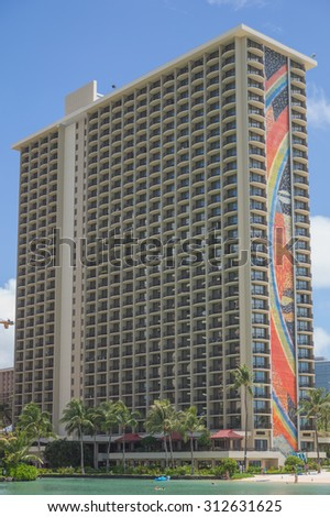 Honolulu, Hawaii, USA, Sept. 3, 2015:  Morning closeup view of the world famous Hilton Rainbow Tower on Waikiki Beach.  Hilton Hawaiian Village is a world famous family vacation destination.