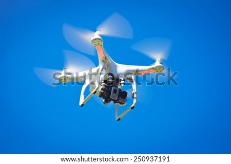 HONOLULU, HI - FEB 8, 2015: Photo of DJI Phantom 2  quadrocopter drone with GoPro Hero3+ attached to gimbal. DJI Industries makes a wide range of UAV's for recreation and business. - stock photo