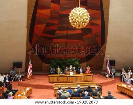 HONOLULU, HI - JANUARY 14: Governor Neil Abercrombie speaks from podium to Hawaii state Legislature at event to honor Former U.S. Senator Daniel Akaka. January 14, 2013 Honolulu, Hawaii. - stock photo
