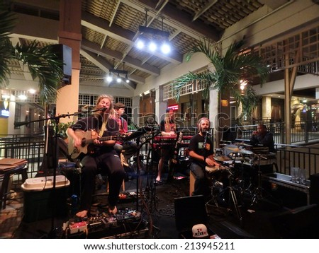 HONOLULU, HI - JULY 30: Band Mike Love Jams at Mai Tai Bar in Ala Moana Shopping Center on July 30 2014, Honolulu, Hawaii. - stock photo