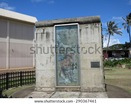 HONOLULU, HI - JUNE 4, 2015: Piece of the berlin wall on Display at Honolulu Community College Campus in island of Oahu in the state of Hawaii. - stock photo