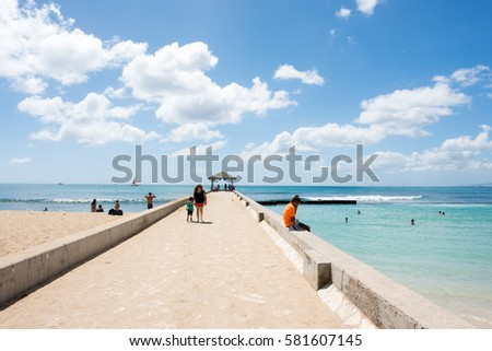 Honolulu, HI: September 27, 2016: People enjoying the beach in Waikiki. Waikiki has about 72,000 tourists on any given day.