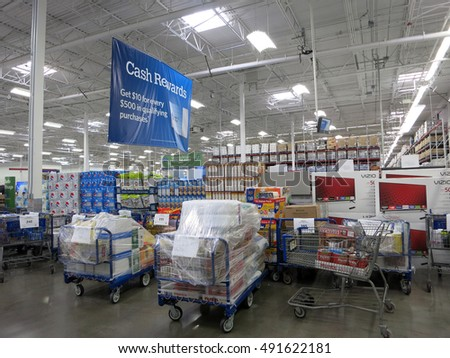 HONOLULU - JANUARY 4, 2016: Sam's Club interior with pick up orders ready for pick up and products. Sam's Club is American chain of membership-only retail warehouse clubs owned, operated by Walmart.