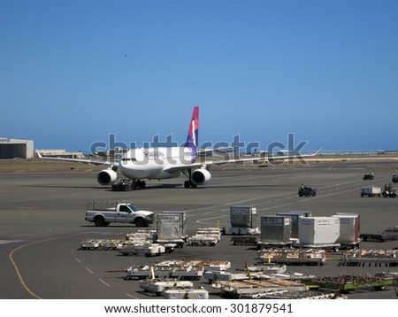 HONOLULU, JUNE 26: Hawaiian Airlines airplanes taxis out to runway as it prepares for take off at Honolulu Internation Airport, Honolulu, Hawaii on June 26 2015. - stock photo