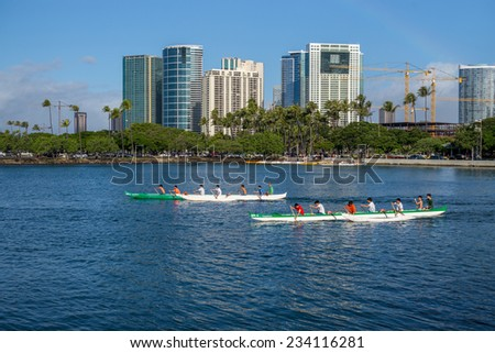 Honolulu, Nov, 29, 2014:  Paddlers from Mid Pacific Institute practice for the upcoming Hawaii State Canoe Championships.  Honolulu, Hawaii, USA. Nov. 29, 2014. - stock photo