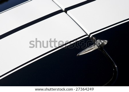Hood and hinge of sports car - stock photo