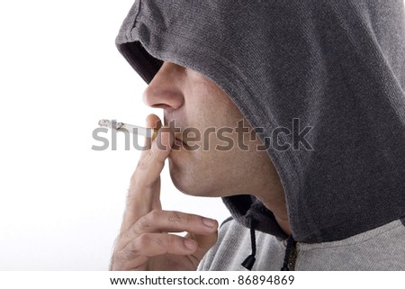 hood profile guy taking a cigarette and smoking - stock photo