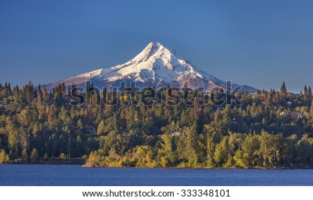 HOOD RIVER, OREGON, USA - SEPTEMBER 19, 2015: Mount Hood, 11,241 ft (3,429 m) glaciated mountain in Cascade Range, and the Columbia River. - stock photo