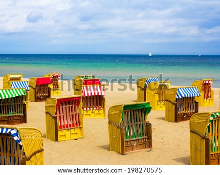 Hooded beach chairs at Baltic Sea - stock photo