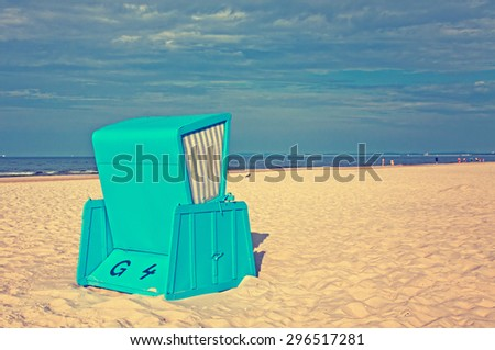 Hooded beach chairs (strandkorb) at the Baltic seacoast in Swinoujscie, Poland (Instagram filter) - stock photo