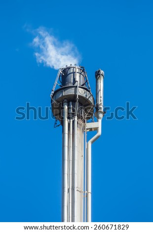Hooded gas combustion device in oil refinery plant of Kapotnya in Moscow, Russia