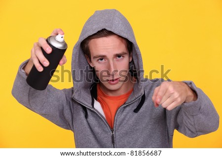 Hooded youth with paint can - stock photo