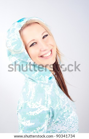 Hoodie girl smiling on white background - stock photo