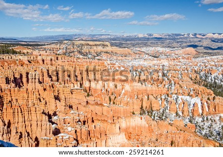Hoodoos, snow, and an incredible view of Bryce Amphitheater from Inspiration Point in Bryce Canyon National Park - stock photo