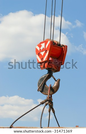 Hook crane, slings and cargo on a cloudy sky - stock photo