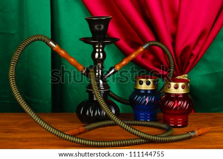 hookah on a wooden table on a background of curtain close-up