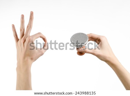 Hookah topic: Bartender holding a clay bowl with tobacco for hookah covered with a foil with holes isolated on a white background