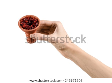 Hookah topic: Bartender holding a clay bowl with tobacco for hookah isolated on white background - stock photo