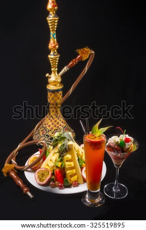 Hookah with Fruit vitamin tropical cocktails passion fruit,  melon, pineapple and grapes on black  - stock photo