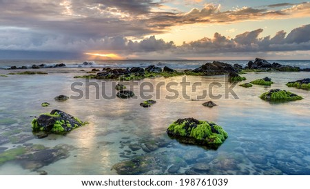 Hookipa sunset rays on the island of maui, Hawaii - stock photo