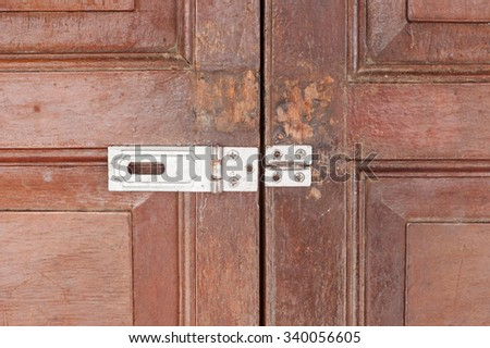 hooks in wooden open door close-up - stock photo