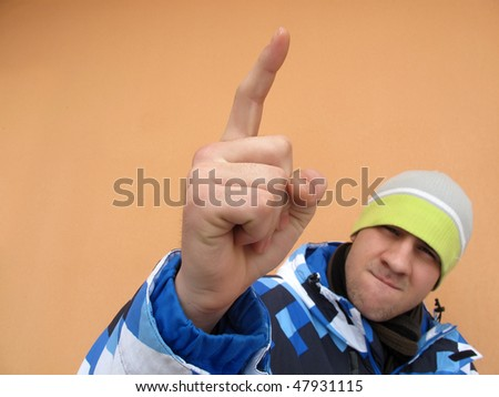 Hooligan bully violent man is threatening by finger - stock photo