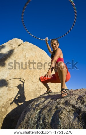 Hoop dancer performing in the California desert, on a summer afternoon.