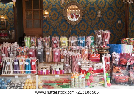 HOORN,THE NETHERLANDS - AUGUST 13 ,2014: Wide angle picture of a colorful  candy stall with lollipop, s nougat and confectionery at the funfair on August 13,2014 in Hoorn.  - stock photo