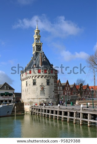 HOORN, THE NETHERLANDS - FEBRUARY 19: Hoofdtoren on February 19, 2012 in Hoorn, The Netherlands. The Hoofdtoren is a 16th century defense tower by the old harbour. Nowadays the tower is a restaurant. - stock photo