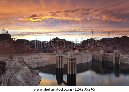 Hoover Dam. Image of Hoover Dam and bridge during dramatic sunset. - stock photo