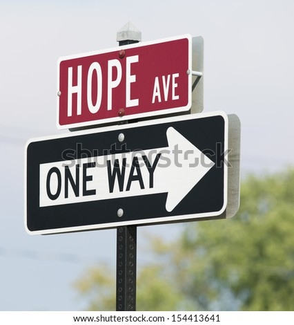 Hope Avenue and One Way Traffic Signs together in the same picture. - stock photo