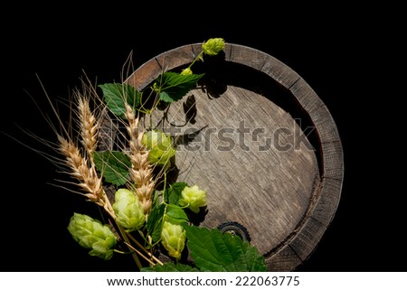 hope branch& wheat ears on the old oak barrel. Isolated on black.  - stock photo